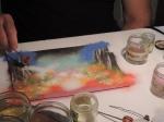 Seguin Poirier applying paint powder to enamel