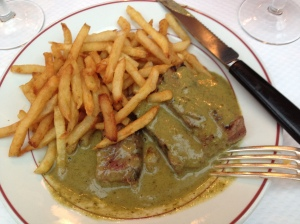 Streak and frites, smothered in a rich thyme butter sauce, Le Relais L'Entrecote, Paris