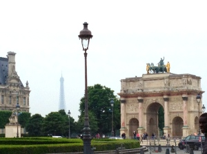 Arc de Triumphe', with the tip of the Eiffel Tower in the background, Paris