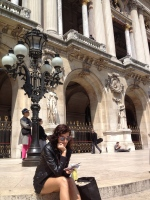 Reading a book on the steps of the National Opera House, Paris