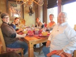 Family and friends sharing a Thanksgiving meal in Arizona.