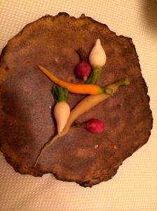 Locally grown miniature veggies served on natural cut wood platter, The Restaurant