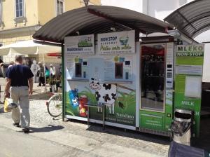 Fresh milk kiosk, where each one is serviced directly by the farmer, Ljubljana food market
