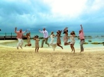 Bridal party jumping for joy on the beaches of Cancun, Mexico