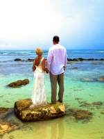 Bride and groom look off into their new future together, Cancun, Mexico