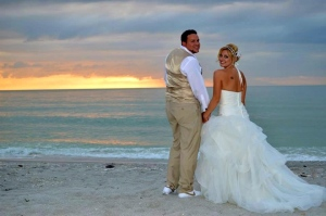 Bride and groom sharing their first sunset as man and wife, Captiva Island