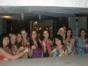 The gals sharing an exotic foo-foo drink at the bachelorette party in Playa del Carmen