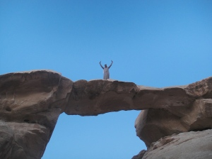 Suleman waving at us from atop the natural archway in Wadi Rum, Jordan