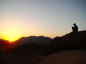 Watching the sun come up over the Arabian Desert while enjoying a hot cup of java