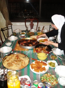 Mrs. Taghreed overseeing a family dinner at the home of Abu Jawad