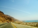 The rugged landscape of Jordan along one side of the road that has the Dead Sea flanking the other side of the road. What history in that one square mile of land.
