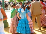Local woman dressed in traditional style flamenco dresses at the April Fair, Seville, Spain