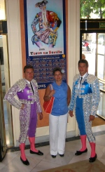 Posing with two of Spain's most prized bullfighters, Seville, Spain