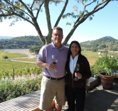My husband and I enjoying a glass of fine wine at Joseph Phelps winery in Napa Valley