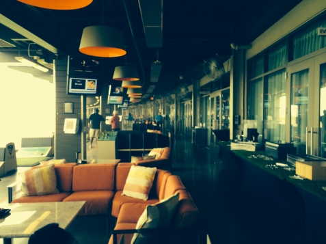 Cushy seating under the fans and misters at Top Golf.