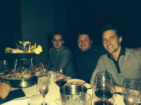 the fellas enjoying surf and turf at Mastro's Steakhouse