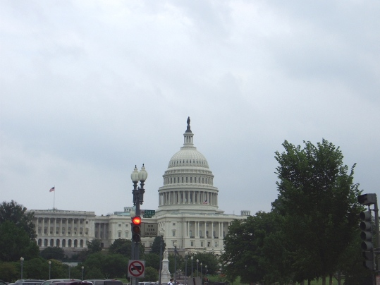 U.S. Capitol with Statue of Freedom reaching high up into the heavens