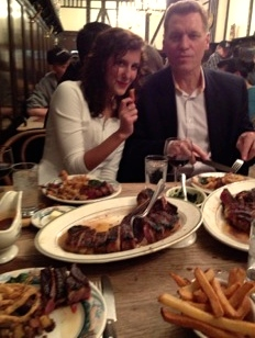Enjoying the tender short loin bone-in steaks at Peter Luger Steak House, Brooklyn