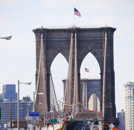 Old glory waves in the in the window of the west tower of the Brooklyn Bridge - days after two German's exchange the flags for bleached out American Flags - apparently to honor the 130th anniversary of the German designer of the bridge - Joseph Roebling