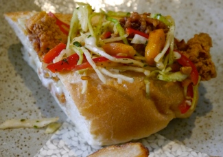 At Husk we enjoyed a Fried Chicken Po'Boy sandwich topped with peanuts, red peppers and slaw.