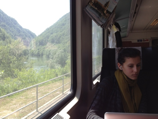 On the train, taking in scenery and an opportunity for some reading enroute from Vienna to Ljubljana, Slovenia.