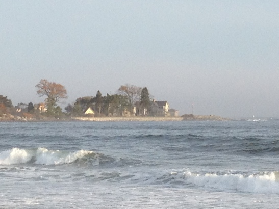 The waves crashing into the beach along the Kennebunk seaboard - could that be the Bush compound in the background??