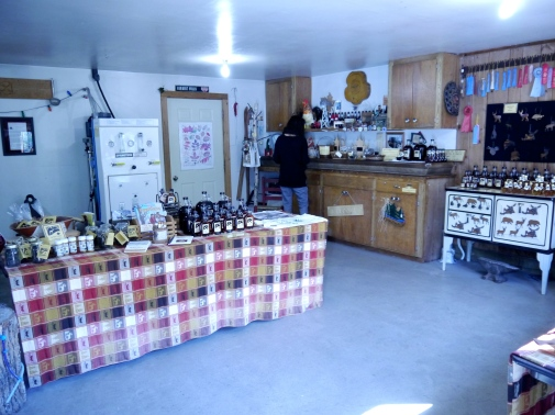A cabin store full of many different local homemade goods like Caribou Cream syrup.