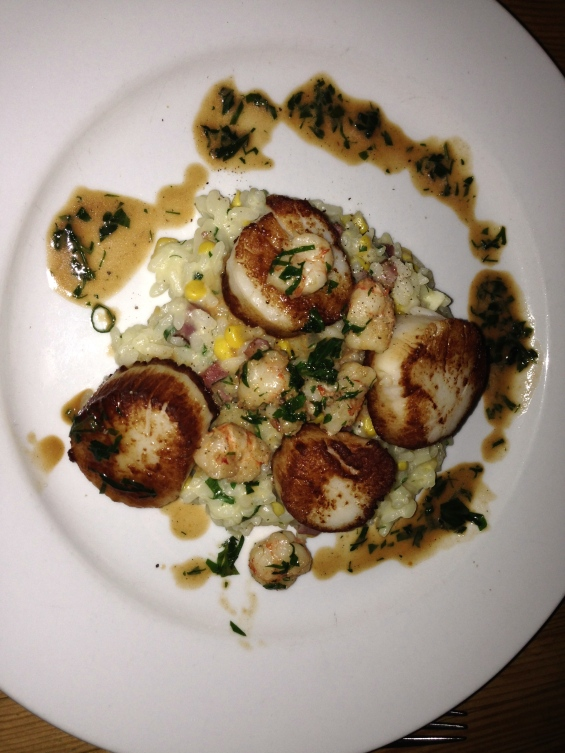 Sauteed sea scallops perfectly browned and put to rest on a bed of corn infused risotto.