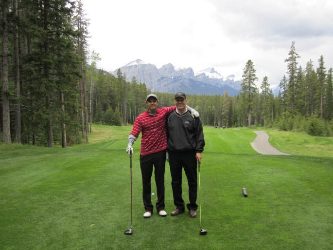 Golfing in Canada with glacial mountains providing a majestic backdrop.