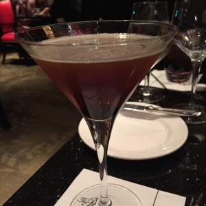 A Maple Manhattan, straight up, with a candied bacon garnish - to wash down that crab cake at Chaz.