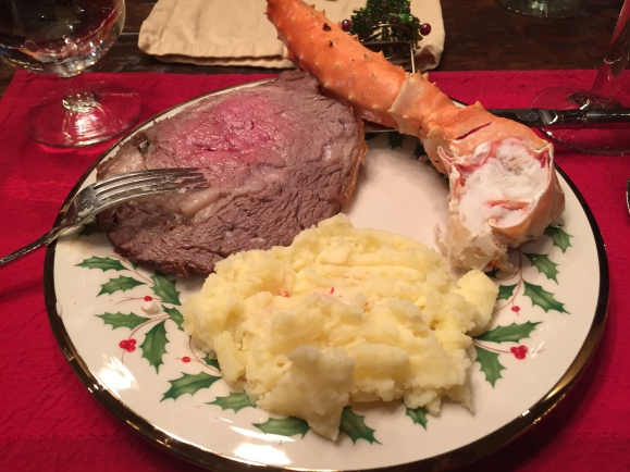 Filling up on the basics - beef tenderloin, giant king crab leg and extra creamy mashed potatoes - at home on Christmas Eve.