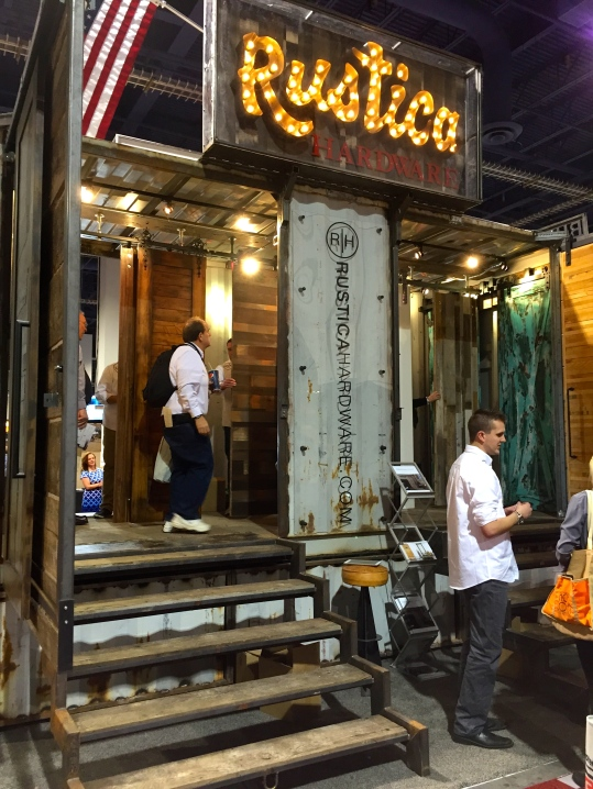 A unique vendor showcases their rustic and distressed barn doors and hardware