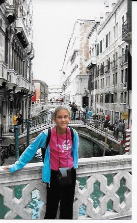 The Bridge of Sighs, in the background, spans one of the inland canals in Venice.