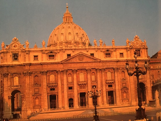 St. Peter's Basilica bathed in the light from the setting sun.