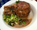 Double pork chop, breaded, served over creamed brussel sprouts with house-smoked bacon.