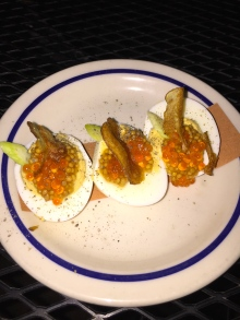 Deviled eggs topped with trout roe is a tasty way to start off an evening of tasty seafood dishes at Extra Fancy in Brooklyn.