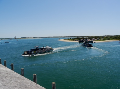 Two mini ferries take turns taking vehicles and people back and forth between Edgartown and Chappaquiddick Island.