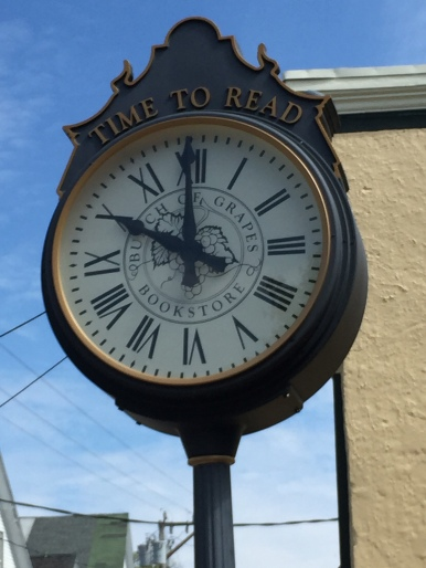 "The outdoor time clock in front the bookstore - ""Time to read"""