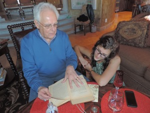 Grandpa, once an English and History teacher, sharing with his granddaughter one of his favorite historical novels.