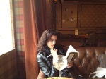 My daughter reading in a Parisian cafe' - oh there's that glass of wine!