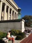 My daughter reading at the base of Low Library on the Columbia University campus.