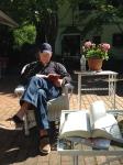 Husband reading on the patio at the Charleston Inn on Martha's Vineyard.