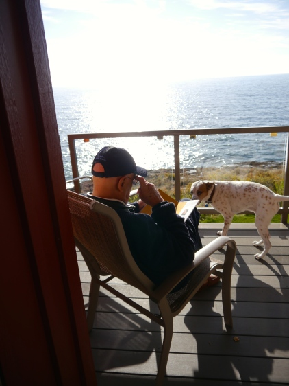 Grandpa reading to Eli, while looking out of Lake Superior on a beautiful spring day - which he will journal about early the next day.
