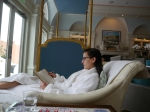 My daughter reading while waiting for a massage at the Glenmere Mansion in New York.