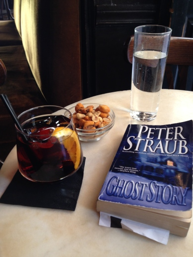 Vermouth and vacation reads at Café de Ruiz, Madrid.
